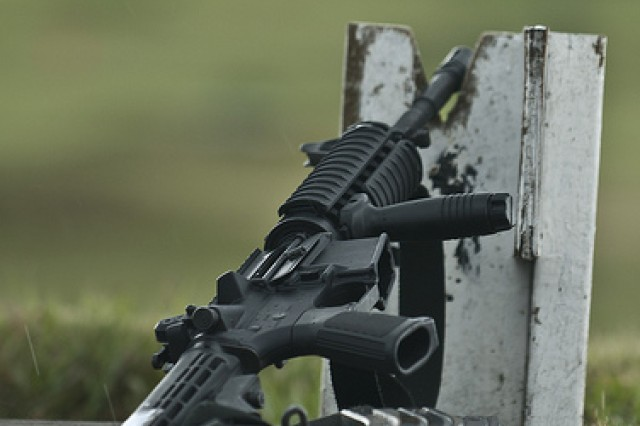 A soldier's assigned weapon, the M4, sits in a V-notch stake in between fire positions during the Rifle Qualification event 2011 Army Reserve Best Warrior Competition at Fort McCoy Wis., on June 22. This event tests a soldiers ability to maintain their marksmanship skills, which is one of the most valuable assets for a soldier.