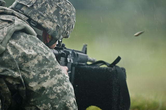 A soldier fires his assigned weapon as the rain pours down during the Rifle Qualification event at the 2011 Army Reserve Best Warrior Competition at Fort McCoy Wis., on June 22.