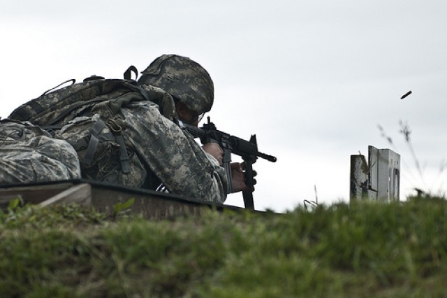 A shell casing is ejected as a soldier fires his assigned weapon during the Rifle Qualification event at the 2011 Army Reserve Best Warrior Competition at Fort McCoy, Wis., on June 22.