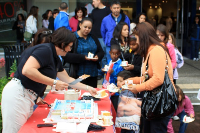 MONTEREY, Calif. - Military families and community members line up for cake at the Del Monte Shopping Center on June 4.