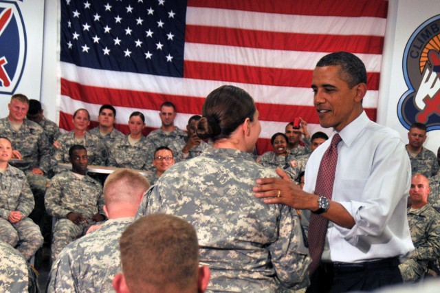 Inside 10th Combat Aviation Brigade's dining facilities Thursday, President Barack Obama shakes hands and thanks Soldiers of 1st Brigade Combat Team, 10th Mountain Division (LI), for their dedicated service to the nation, particularly in Afghanistan, since the terrorist attacks of Sept. 11, 2001.