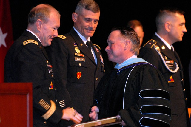 Gen. Martin Dempsey, Army chief of staff, congratulates civilian instructor of the year Dr. Kevin Shea, Department of Command Leadership, during the Command and General Staff College's graduation for the Intermediate Level Education 2011-01 class June 10 at the Lewis and Clark Center. Lt. Col. Leonard Lira, Department of Joint, Interagency and Multinational Operations, was honored as military instructor of the year.