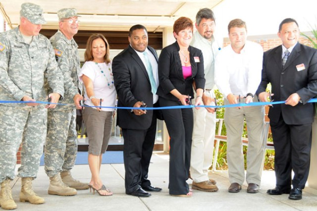 Fort Rucker, Lend Lease and IHG officials cut the ribbon at the official opening of Fort Rucker's Holiday Inn Express June 16.