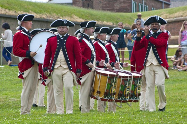 The Army Old Guard Fife and Drums Corps performs Saturday for visiting crowds at the Fort McHenry National Monument and Historic Shrine in Baltimore. The performance was part of the Twilight Tattoo ceremony featuring the Army's timeline in history.