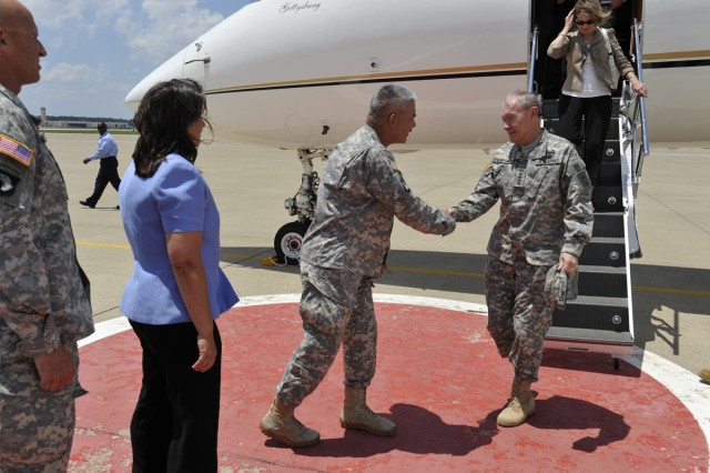 The Chief of Staff of the Army (CSA) General Martin E. Dempsey is greeted by Maj. Gen. John F. Campbell during a visit to Fort Campbell, Ky., where he and his wife Deanie met with Soldiers and their spouses June 23, 2011. Dempsey thanked the Soldiers and families for the sacrifices they have made during the conflicts in Iraq and Afghanistan.