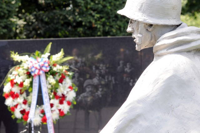 During a ceremony at the Korean War Veterans Memorial in Washington, D.C., June 24, U.S. and Korean military officers, as well as the Korean ambassador to the United States, Han, Duck-soo, and military attachés from nations involved in the war, laid wreaths to remember the conflict and those who were died fighting in it.