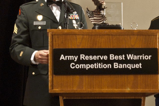 Sgt. Christopher R. Couchot with the B Company, 98th Expeditionary Signal Battalion from Mesa, Ariz., speaks to a crowd of competitors, sponsors, and cadre after recieving the 2011 Army Reserve Best Warrior Competitions Non-Commissioned Officer trophy during the Awards Ceremony at the American Legion in Sparta Wis., on June 24.