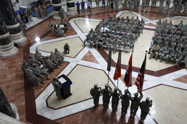Lt. Col. Kathy Fox, 50th Signal Battalion (Expeditionary) Commander, addresses the troops at Al Faw Palace on Victory Base Complex, Baghdad, Iraq. With the drawdown of forces looming in Iraq, Soldiers of the 50th will face some unique challenges.
