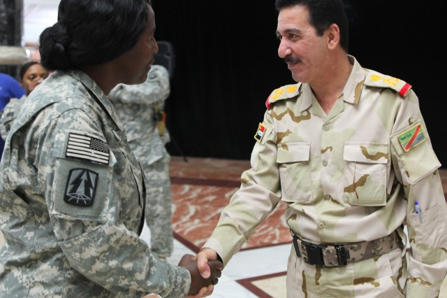 Col. (P) Kaffia Jones, Commanding General of 335th Signal Command (Theater) (Provisional) greets Brig. Gen. Ra'ed Shaker Khudhair, the Iraq Army G6, at the Transfer of Authority ceremony at Al Faw Palace.