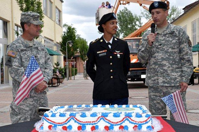 Col. Robert C. Doerer, commander of 12th combat Aviation Brigade (left), Pfc. LaBrea Barnfield, Headquarters Company, 2d Battalion, 159th Aviation Regiment and Col. Christopher M. Hickey, commander of USAG Ansbach , (right) prepare to cut the Army Birthday cake at Storck Barracks, Illesheim, Germany.
