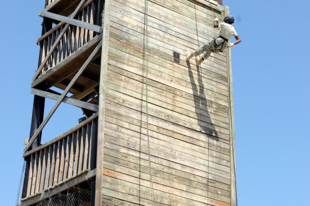 Cadets rappel down a 42-foot tower June 15, 2011, during a week-long summer camp for JROTC students.