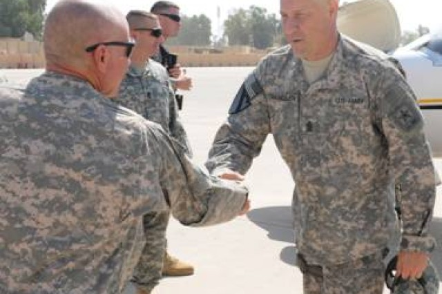 COS MAREZ, Iraq - Command Sgt. Maj. John Jones, senior enlisted leader, 1st AATF, 1st Inf. Div., greets Sgt. Maj. of the Army Raymond F. Chandler III, during Chandler's visit to COS Marez and COS Diamondback, in Ninewa province, Iraq, June 23, 2011.