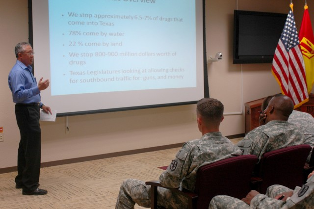 FORT HOOD, Texas -- Edwin Ballarta, a Department of Public Safety specialist, discusses drug trafficking statistics to leaders of the 41st Fires Brigade during a risk reduction and health promotion meeting, June 22.