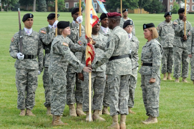 Maj. Gen. Rodney O. Anderson, deputy commanding general of the XVIII Airborne Corps and Fort Bragg, passes the 3d Sustainment Command (Expeditionary) colors to Col. Kristin K. French as she took command of the unit from Brig. Gen. Robin B. Akin during a change-of-command ceremony here June 28. (U.S. Army photo by Sgt. Michael Behlin)