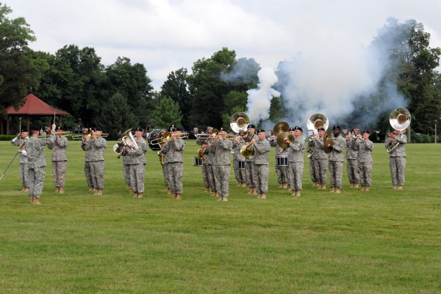 Canons blast as Fort Knox's 113th Army Band plays during the 3d Sustainment Command (Expeditionary) change of command ceremony at Brooks Field on June 28. (U.S. Army photo by Sgt. Michael Behlin)