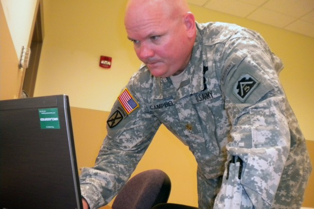 Maj. Chris Campbell, U.S. Army North, prepares to brief the Command and Control Chemical, Biological, Radiological, Nuclear Response concept of support for the Vibrant Response 12 and 12A Field Training Exercise to be conducted in August.