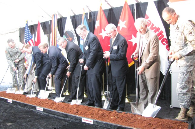 Getting their shovels ready to break ground for Raytheon's Standard Missile production facility at Redstone Arsenal are, from left, Missile Defense Agency commander Lt. Gen. Patrick O'Reilly, Rep. Robert Aderholt, Sen. Richard Shelby, Dr. Taylor Lawrence and William Swanson of Raytheon, Gov. Robert Bentley, Sen. Jeff Sessions, Rep. Mo Brooks and Arsenal senior commander and Aviation and Missile Command commander Maj. Gen. Jim Rogers. Ground was broken on the new facility on June 27.