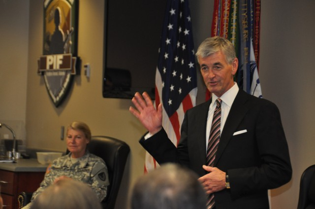 Secretary of the Army John McHugh speaks to employees at the Prototype Integration Facilitiy at Redstone Arsenal during a visit to the Army Materiel Command's new headquarters. In the background is Army Materiel Command Gen. Ann Dunwoody.