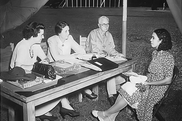 Mary Adair (right) takes an examination at Fort McPherson June 20, 1942, for entrance into the Women's Army Auxiliary Corps (WAAC) Officers Candidate School. Fort McPherson has seens its share of evolution in the Army in its 126 year existence, serving Soldiers in the Spanish-American War, both World Wars, Korea and Vietnam among other conflicts. Times have changed a great deal since the post first opened its gates in 1885, with changes such as the creation of the WAAC and its integration into the regular Army.