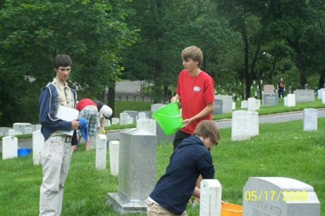 """Tyler """"TJ"""" Ellwein, left,  oversees headstone cleaning.  Also pictured are Garrett Nixon (standing) and Michael Venter."""