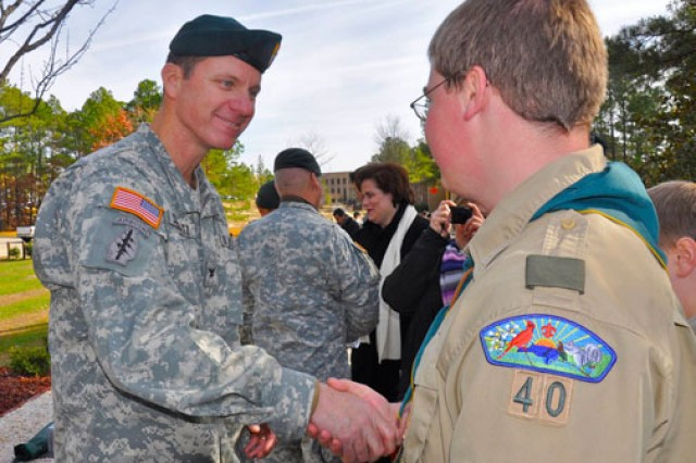 Col. Mark Schwartz, commander of 3rd Special Forces Group, congratulates Jacob Netzel for his work on a walkway commemorating 3rd SFG Soldiers killed in Iraq and Afghanistan.