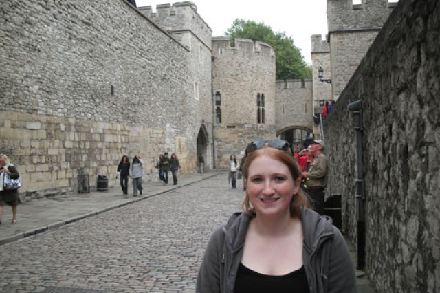 Spc. Kelly Iser poses outside the entrance to the Tower of London, one of many stops on her U.K. R&R;trip.