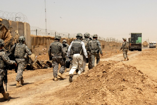 U.S. officials approach Joint Security Station Al Sheeb in Maysan Province, Iraq, in preparation to turn over control of the station to the Iraqi Army, Jun 19, 2011.