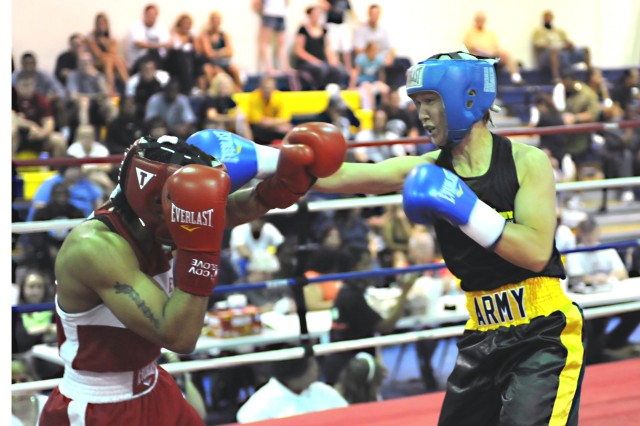 U.S. Army World Class Athlete Program boxer Spc. Carrie Barry scores with a right jab to the head of Queen Underwood of Tacoma, Wash., in the quarterfinals of the women's 132-pound division of the 2011 USA Boxing National Championships on June 22 at Colorado Springs Christian School in Colorado Springs, Colo. Underwood won the bout, 14-10, eliminating four-time U.S. Nationals champion Barry from the tournament.  (U.S. Army photo)