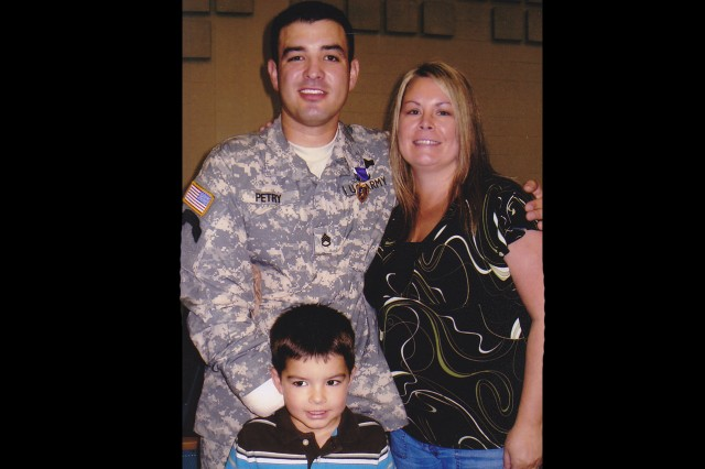Staff Sgt. Petry, his wife Ashley, and their son during the 2008 Ranger awards ceremony where Petry was awarded the Purple Heart.