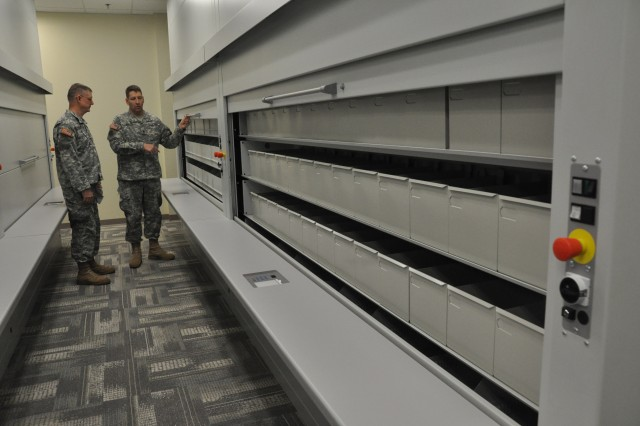 FORT BRAGG, N.C. (June 29, 2011) – Sgt. 1st Class David Wheeler (left) and Staff Sgt. Michael Rhoads check out the sheet music storage system in the library of The Army Ground Forces Band's training facility.