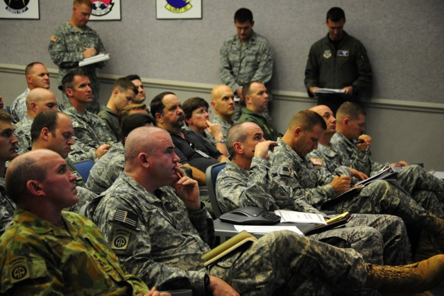 U.S. Military members are briefed on the days mission in support of the Joint Operations Access Exercise, June 26, 2011. A JOAX is a two-week exercise to prepare Air Force and Army to respond to world-wide crisis and contingencies.