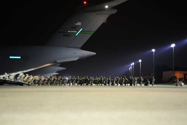 Soldiers with the 82nd Airborne Division, at Fort Bragg, N.C., prepare to board a C-17 Globemaster III before a personnel airdrop mission in support of the Joint Operations Access Exercise, June 26, 2011. A JOAX is a two-week exercise to prepare Air Force and Army to respond to world-wide crisis and contingencies.