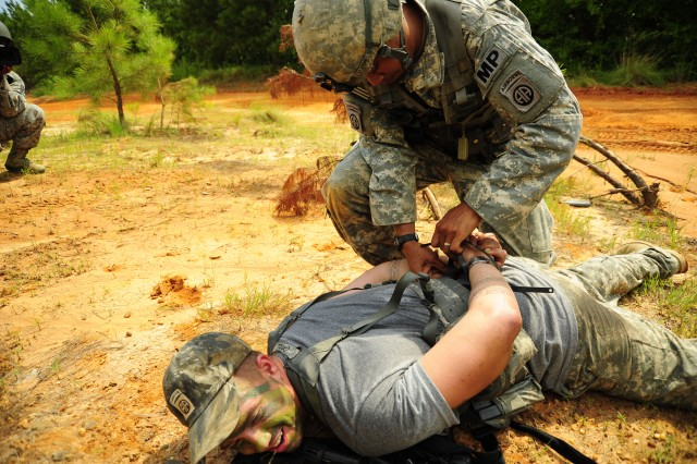 Soldiers with the 82nd Airborne Division, Fort Bragg, N.C., challenge opposing forces during Joint Operations Access Exercise, June 27, 2011. A JOAX is a two-week exercise to prepare Air Force and Army to respond to world-wide crisis and contingencies.