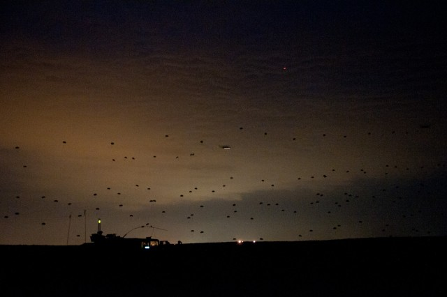Paratroopers with the 82nd Airborne Division's 1st Brigade Combat Team descend on a drop zone at night during a joint operational access exercise, June 26, 2011, at Fort Bragg, N.C.  A thousand paratroopers will land on the drop zone in about 10 minutes.