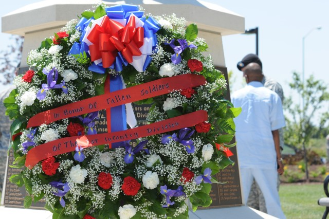 A memorial wreath stands at the base of the Fallen Soldier Memorial in Victory Park on Fort Riley, Kan., June 29, 2011, following the Victory Park Ceremony. Twenty-two Soldiers who died while serving with the division in Iraq or Afghanistan during the past 18 months were honored during the ceremony.