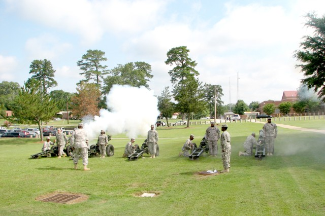 Cannons salute the nation during the playing of the National Anthem at the U.S. Army Forces Command (FORSCOM) color casing ceremony June 24 at Fort McPherson. The ceremony marked the final event in FORSCOM's 38 year history at Fort McPherson. The command, the largest in the Army, will relocate to Fort Bragg, N.C., as part of the 2005 Base Realignment and Closure law.