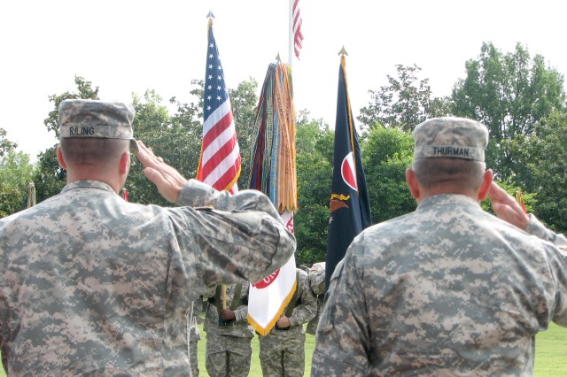 Command Sgt. Maj. Ronald Riling (left), U.S. Army Forces Command (FORSCOM) command sergeant major, and Gen. James Thurman, (FORSCOM) commanding general, salute the national flag during the playing of the National Anthem at FORSCOM's color casing ceremony June 24 at Fort McPherson. The ceremony marked the final event in FORSCOM's 38 year history at Fort McPherson. The command, the largest in the Army, will relocate to Fort Bragg, N.C., as part of the 2005 Base Realignment and Closure law.