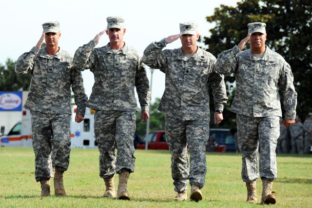 Col. Brian D. Bennett, 1st Avn. Bde commander, Col. Kenneth J. Biland, outgoing commander, Lt. Col. Edward F. Mandril, 1st Avn. Bde. commander of troops, and Maj. Gen. Anthony G. Crutchfield, USAACE and Fort Rucker commanding general, troop the line during a change of command ceremony at Howze Field June 24. Bennett assumed command from Biland.