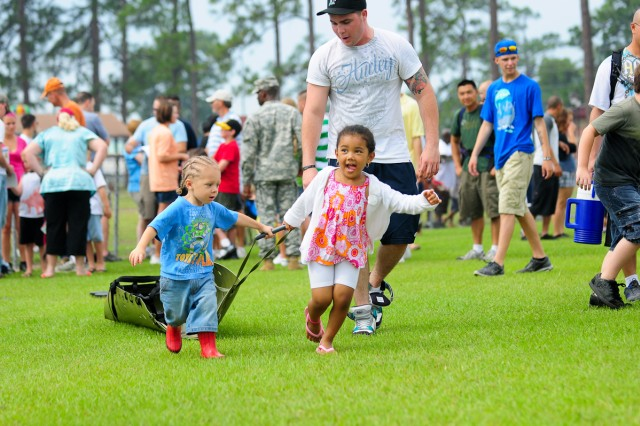 """Children of 3/7 Cavalry Soldiers earn their spurs by pulling sleds during 3/7 Cav. Children's Spur Ride as part of the squadron's """"Gary Owen Day,"""" held June 24."""