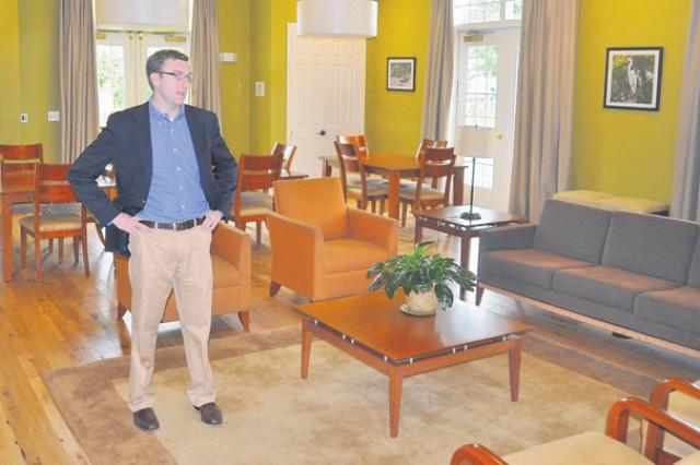 Casey Nolan showcases the Fairfax Village Neighborhood Center's low-emitting building materials.