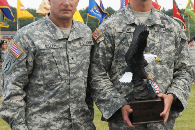 Brig. Gen. Harry E. Miller Jr., left, senior commander Fort Drum, congratulates Staff Sgt. Douglas A Milne, right, 10th Mountain Division NCO of the Year, during the Mountainfest celebration June 23 on Fort Drum. Milne went on to win runnerup in the XVIII Airborne Corps NCO of the Year Competition.
