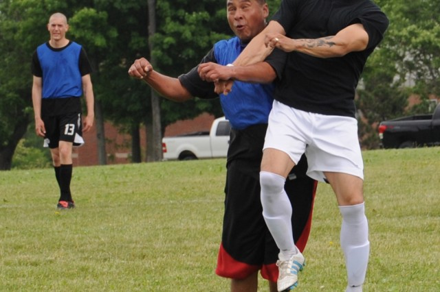 A Soldier from 1st Brigade Combat Team's 1st Battalion, 87th Infantry Regiment goes head on against a 2nd Brigade Combat Team Soldier in the Mountainfest soccer tournament June 22.