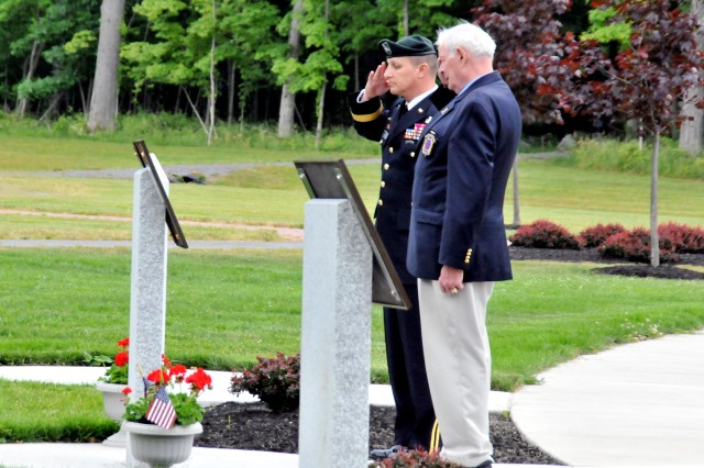 Brig. Gen. Harry E. Miller Jr., left, senior commander Fort Drum, along with Mike Plummer, president of the 10th Mountain Division Association, pay respect June 22 after unveiling the names inscribed on a memorial plaque of the 21 Soldiers of the 10th Mountain Division (LI) who died in Iraq or Afghanistan in 2010. The association donated the monument to be placed in Memorial Park.