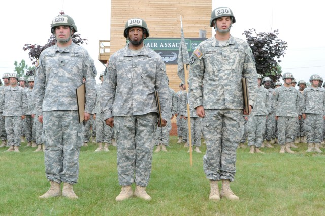 The top three Air Assault School graduates stand in front of their classmates at the Light Fighter School. From left are Spc. John F. Meister, Distinguished Honor Graduate; Sgt. 1st Class Jimmie L. Blockett, Honor Graduate; and Sgt. Bror W. McWhinney, who finished the 12-mile foot march first with a time of 2 hours, 28 minutes.
