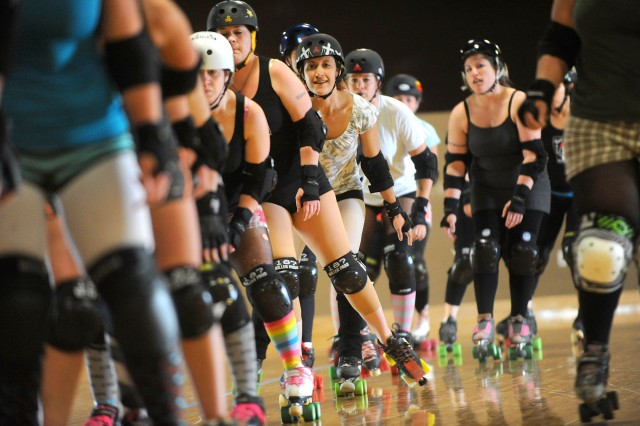 Jess Lundie, center, and other representatives from JBLM's Bettie Brigade will travel to Fort Irwin, Calif., this summer to help their upstart derby team master the rules of the game.