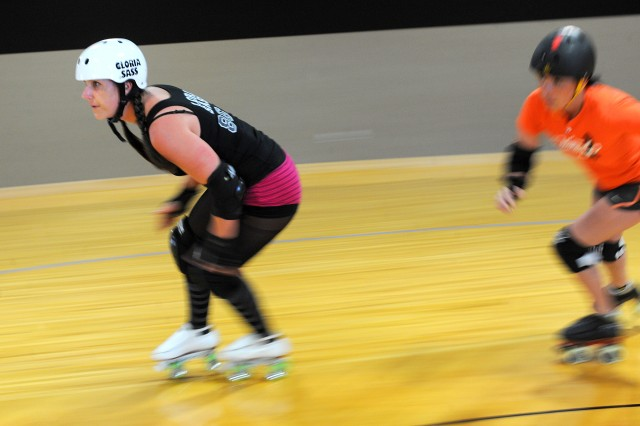 Sarah Howard, left, an Army spouse at Joint Base Lewis-McChord and former Soldier, started the JBLM Bettie Brigade derby league last October. Howard recently created the Military Women's Roller Derby Association, or MWRDA.