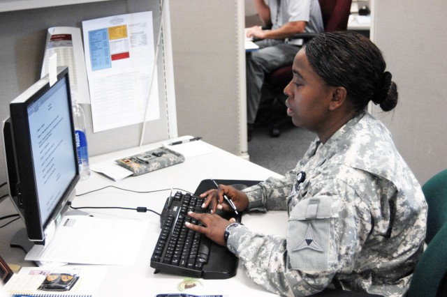 Sgt. Jennifer Jackson, III Corps, works at her computer station in the Inspector General's office. Fort Hood, Texas, Soldiers are now able to complete levy briefings online from any computer station tied to the Fort Hood network.