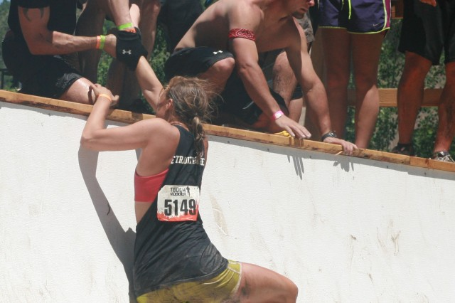 "Teammates help each other up ""Everest,"" an obstacle at the Tough Mudder competition held at Beaver Creek, June 25, 2011."