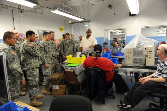 SAN ANTONIO – Jeremy Barnes (center), San Antonio Lighthouse for the Blind quality assurance manager, introduces U.S. Army South Soldiers to his fellow employees at the SALB Jun. 23.
