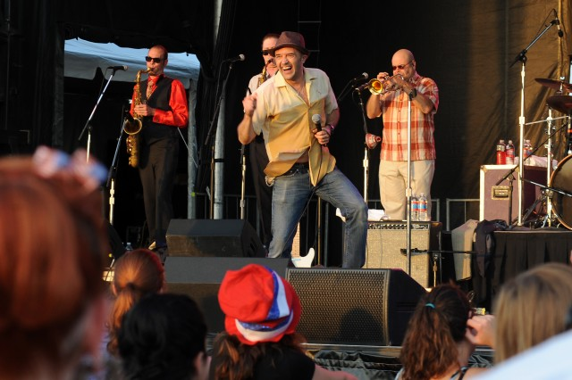 Steve Perry, lead singer of the Cherry Poppin' Daddies, dances to the beat as the band performs during Freedom Fest, July 4, 2011, at Fort Hood's Sadowski Field.